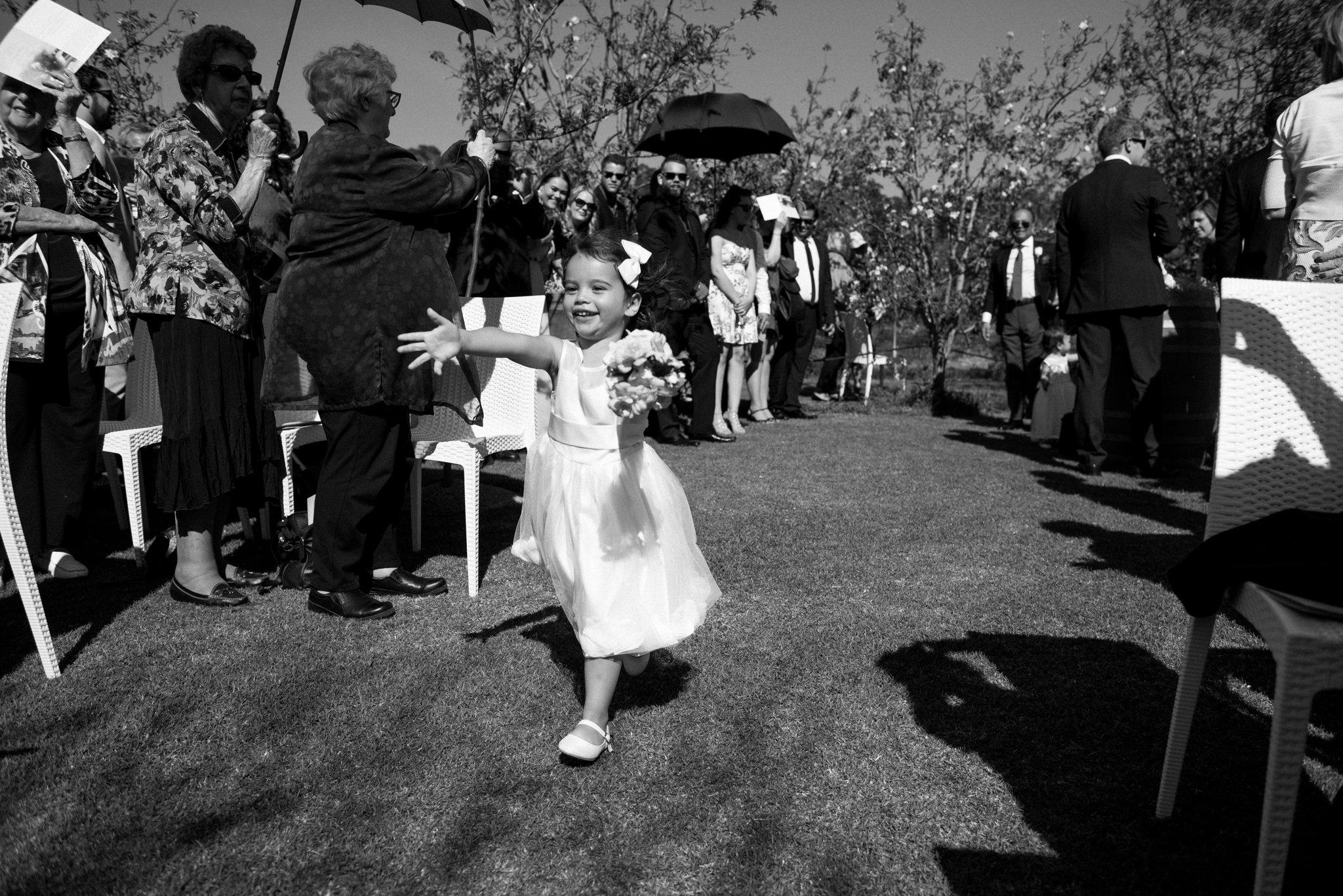 flowergirl running down the aisle