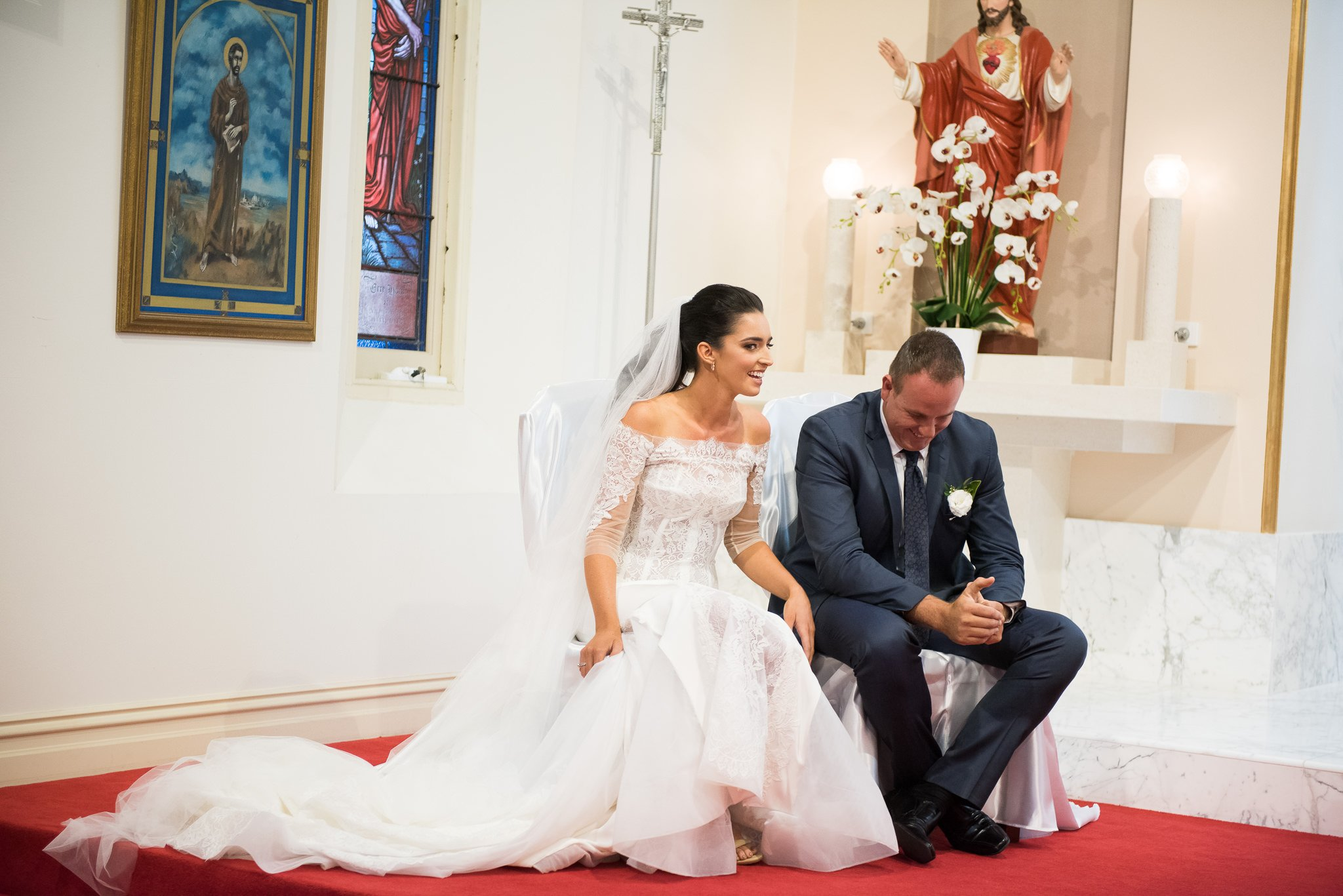 bride and groom candid moment in church