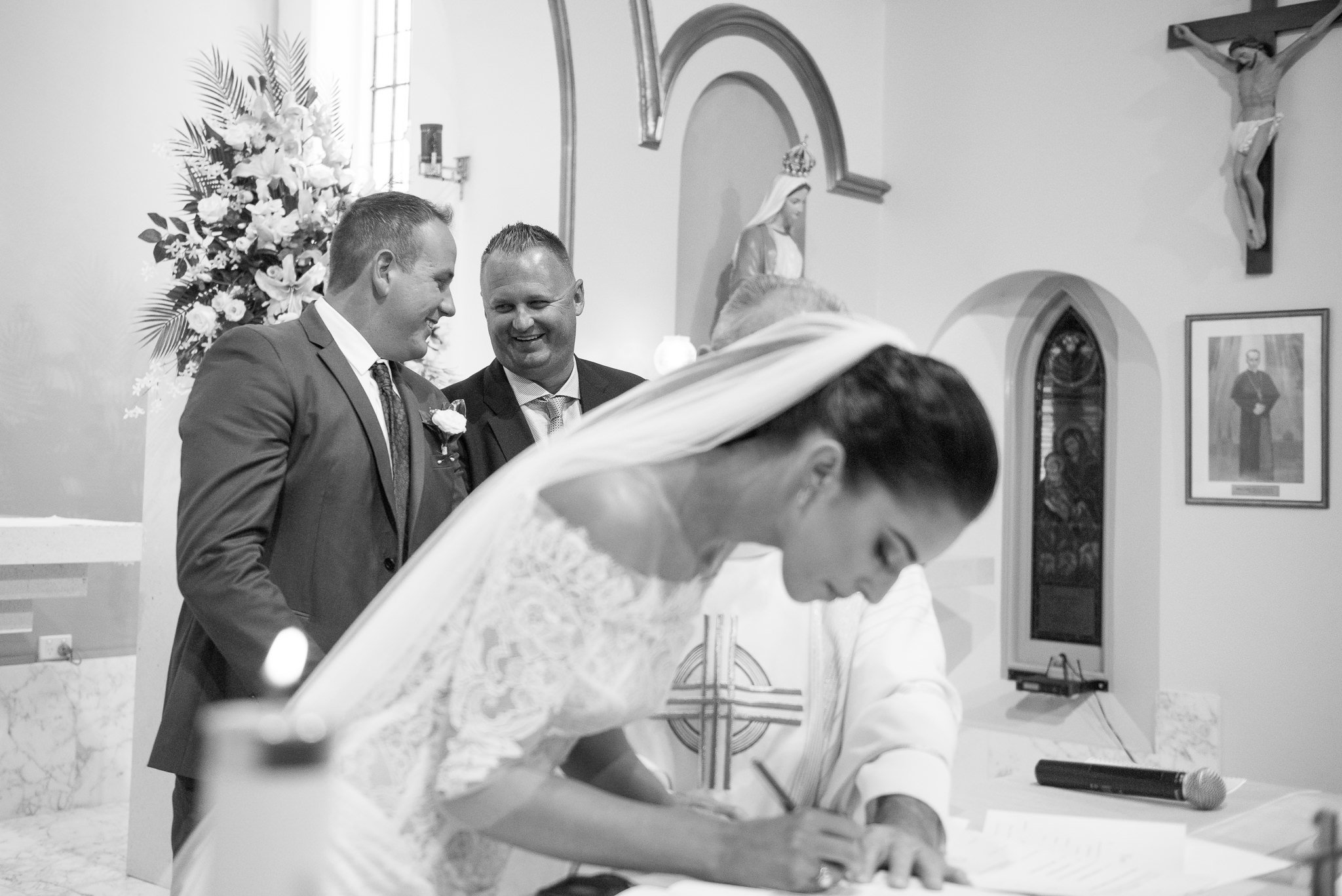 signning the wedding papers