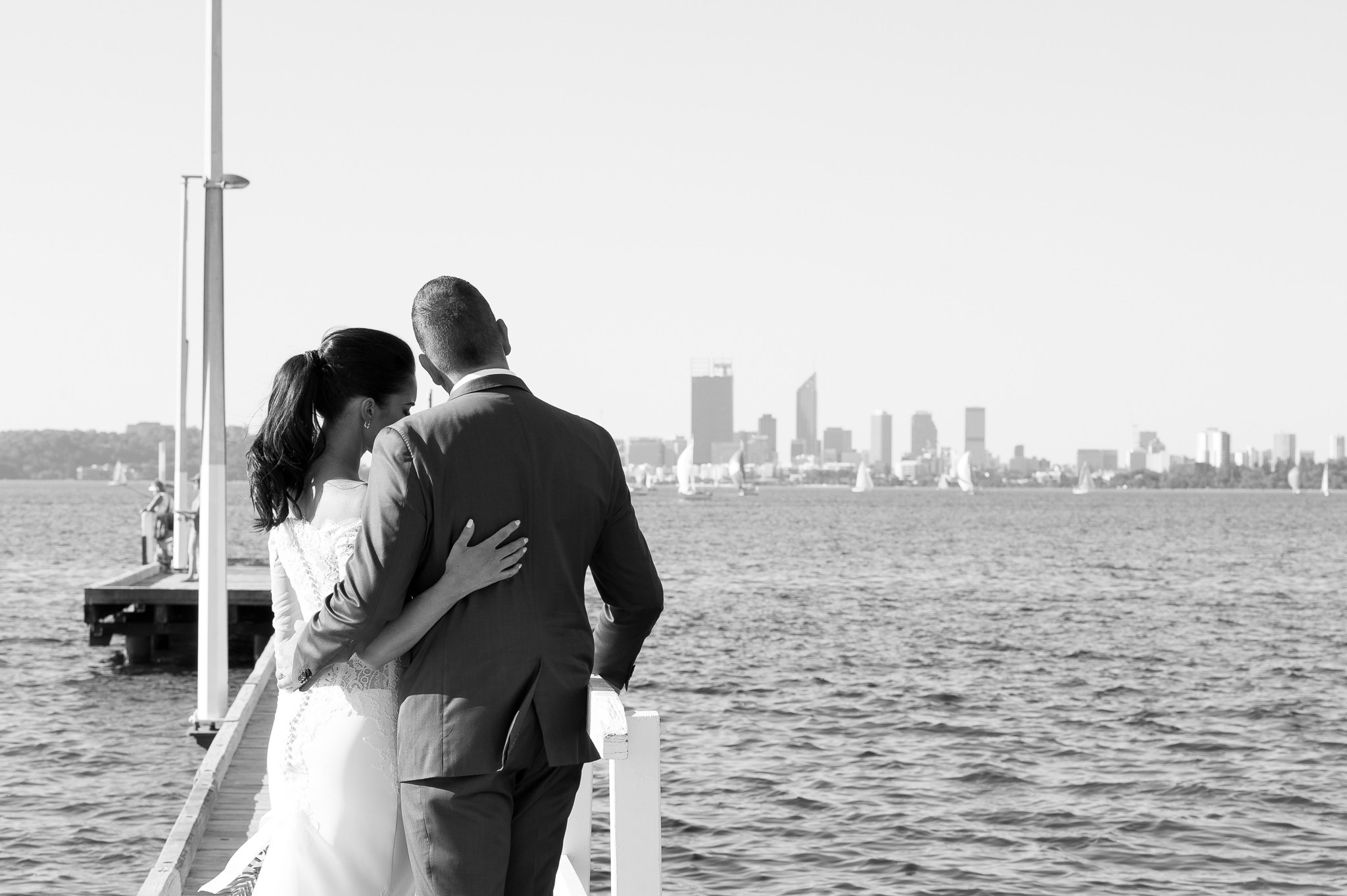 bride and groom with a view to perth