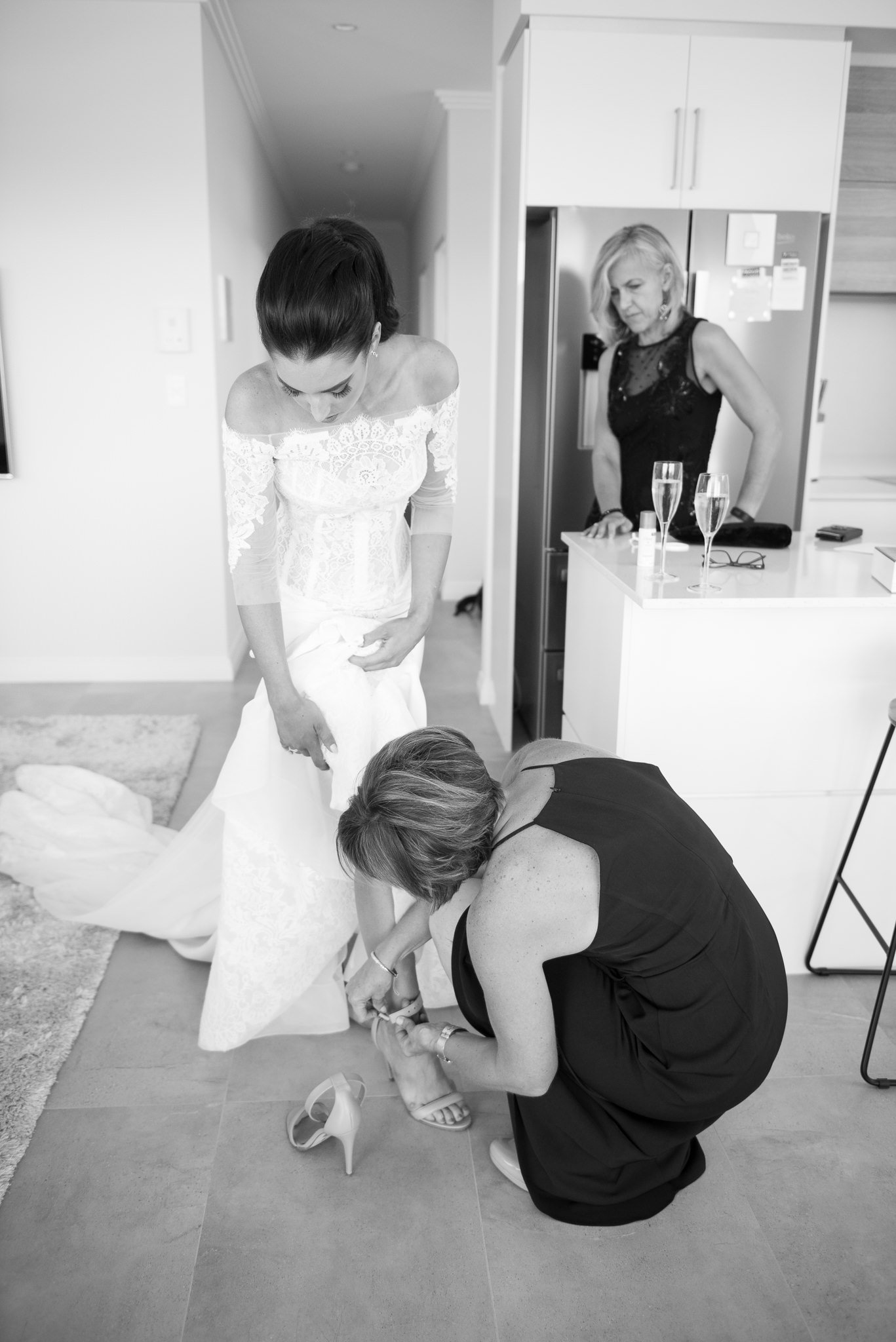 bride getting shoes on
