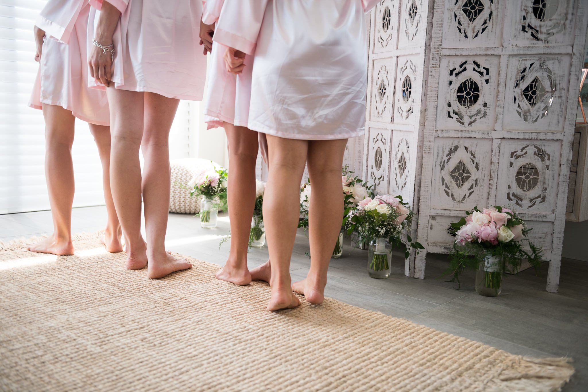 bridesmaids legs and flowers